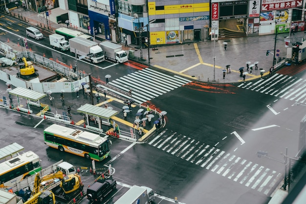Busy crosswalk in the city with traffic