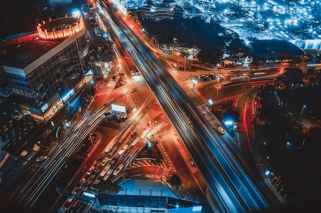 Busy highway road junction in metropolis city center at night