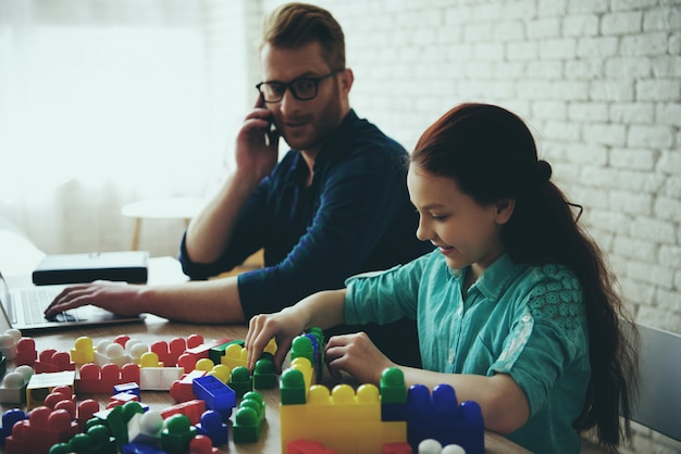 Busy single father works and looks like daughter
