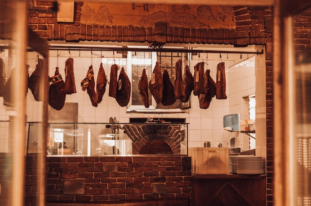 Butcher shop in italy. parma ham. tourism and travel concept.