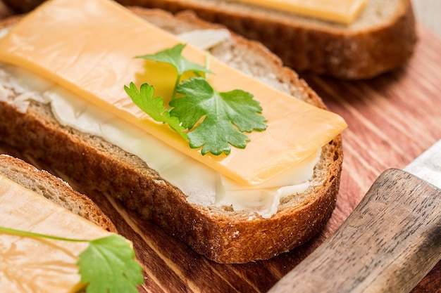 Butter and bread for breakfast, with parsley over rustic wooden surface