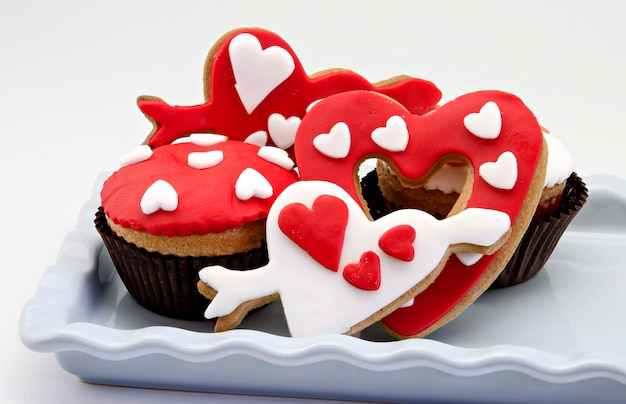 Butter cookies decorated with fondant and cupcake, valentine's day