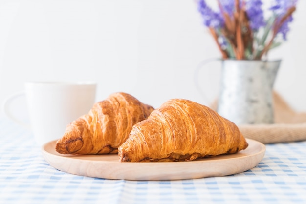 Butter croissant on table
