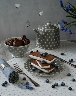 Butterflies and sandwich ice cream with chocolate biscuit cookies. stack of folded ice cream