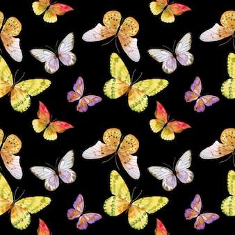 黒の背景に蝶のパターン