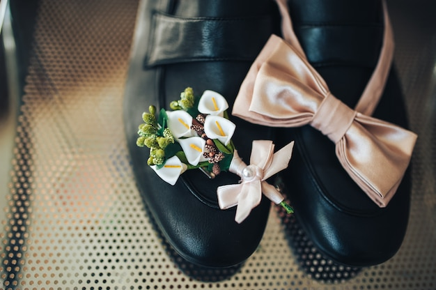 Butterfly tie, boutonniere and shoes