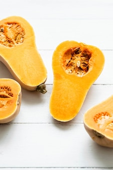 Butternut squash on white table flat lay