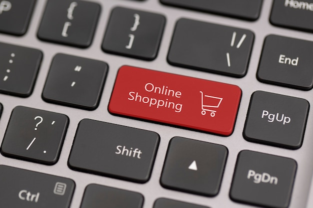 Button with the word online shopping on a keyboard.