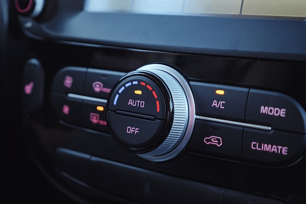 Buttons of radio, dashboard, climate control in car close up