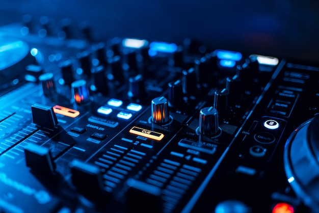 Buttons and volume levels and mixing music on professional board dj