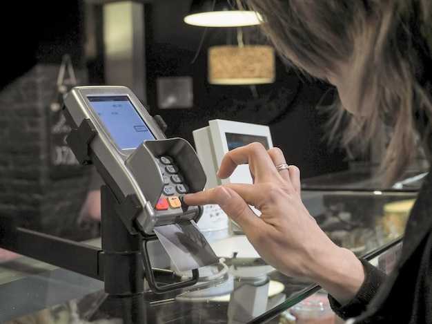 Buyer pays with card purchases. lady buys using your bank card. purchase by credit card.