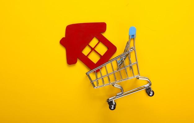 홈 컨셉 구매. 노란색 바탕에 집 그림으로 쇼핑 트롤리. 평면도