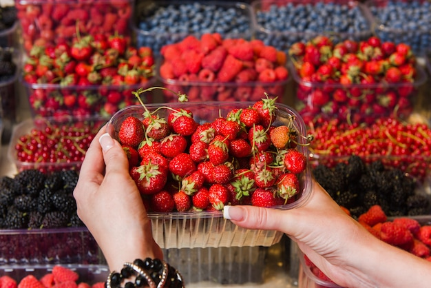 Buying berries in the local market