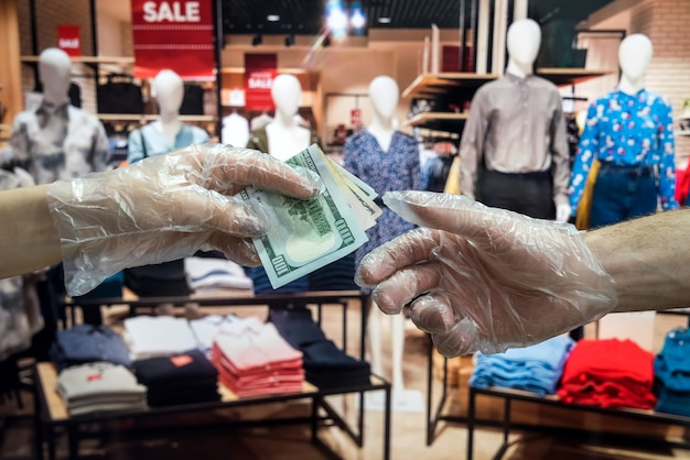 Buying clothes in the store, the buyer pays money for purchase. lifestyle