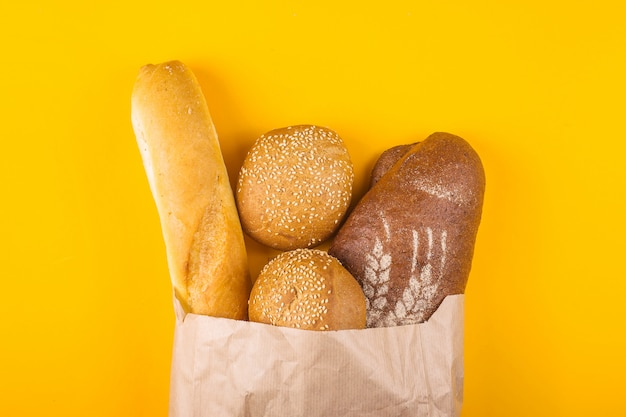 Buying fresh bread in a paper bag concept