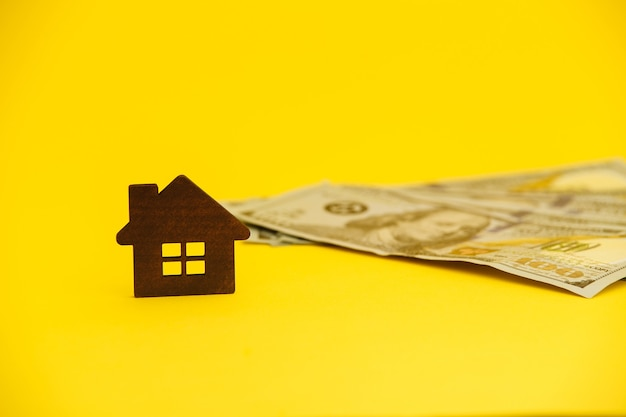 Buying house concept. legal mortgage. hose with money on the yellow table.