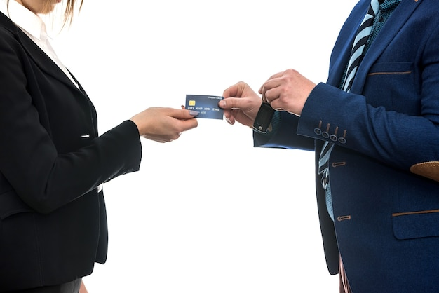 Buying or renting a car. businessmen isolated on white holding credit card and keys.