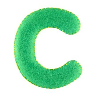 Буква c из войлока на белом фоне