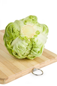 Cabbage on a cutting board isolated on a white