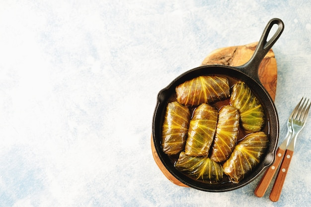 Cabbage leaves stuffed with rice, minced meat in tomato sauce