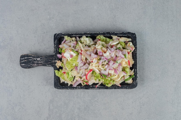 Cabbage and lettuce salad on a wooden board.
