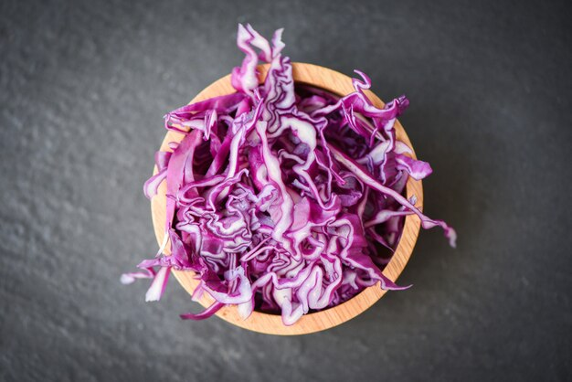 Cabbage purple / shredded red cabbage slice in a wooden bowl