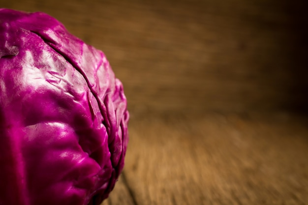 Cabbage purple on wooden. kitchen. morning. closeup
