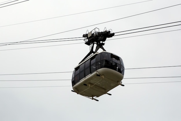 Cabin cableway on a background of cloudy sky.