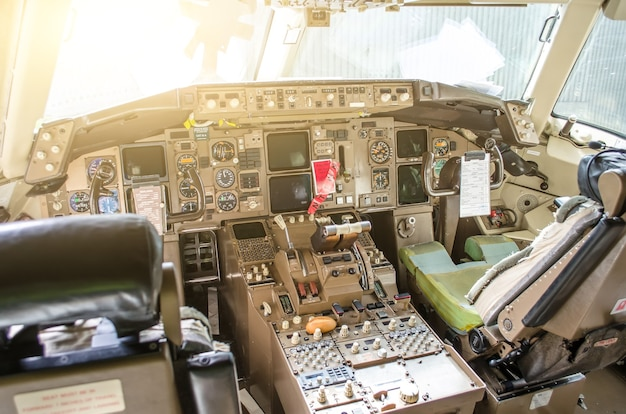 Cabin pilots aircraft view of the windshield, steering wheels, control devices.