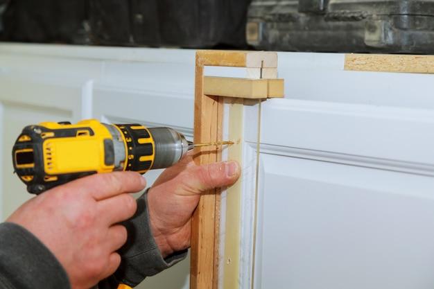 Cabinet door master drills the door in the cabinet door