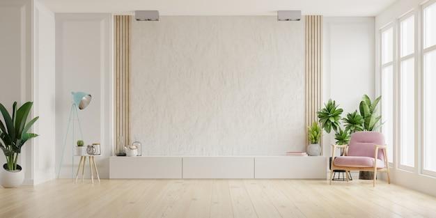 最小限のデザイン、3dレンダリングのアームチェア付きのリビングルームの白い漆喰壁のテレビ用キャビネット