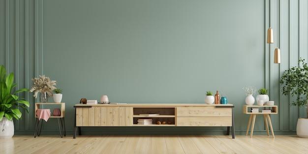 Шкаф-телевизор в пустой внутренней комнате, темная стена с деревянной полкой, лампа, растения и стол из дерева, 3d-рендеринг