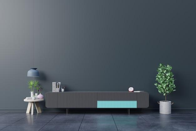 Шкаф телевизор в пустой внутренней комнате, темная стена с деревянной полкой, лампой, растениями и столом из дерева.