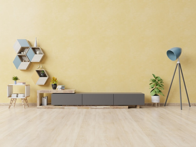 Cabinet for tv or place object in modern living room with lamp, table, flower and plant on yellow wall.