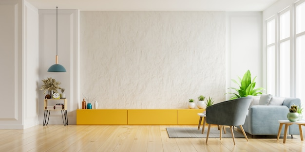 Cabinet for tv on the white plaster wall in living room with armchair and sofa,minimal design.