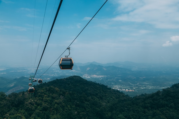 Cable car to ba na hills mountain resort, the multi-level complex filled with amusement rides, attractions on the hill, vietnam