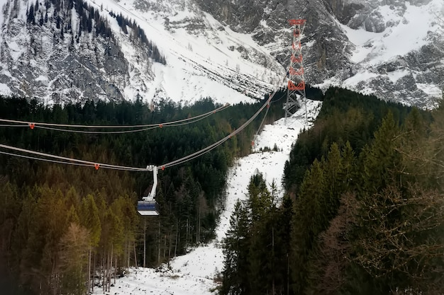 Cable car to mountain peak in alps mountain