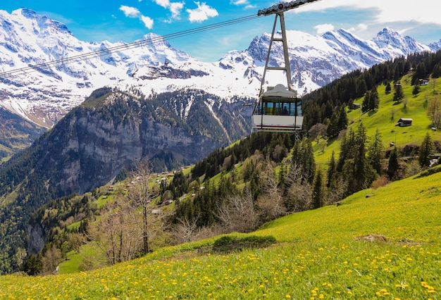 Cable car & view of landscape in the alps at gimmelwald & murren villages in switzerland