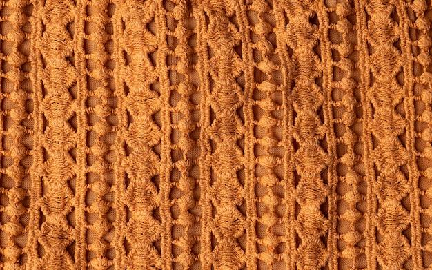 ケーブル編みのステッチパターン、柔らかいウールの手作りのニット服の質感