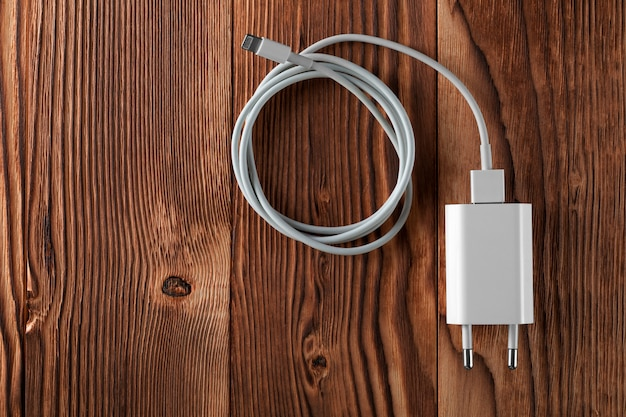 Cable phone chargers on wooden table