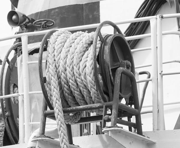 Cable reel with a rope on the deck. of the ship. white and black