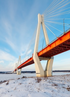 Cable-stayed bridge across frosty river