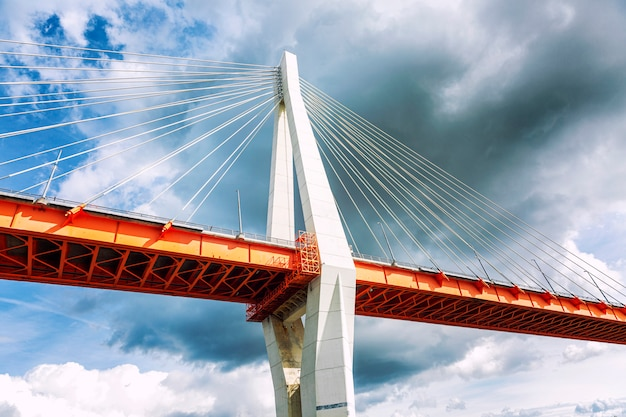 Cable-stayed bridge against a dark sky, close-up.