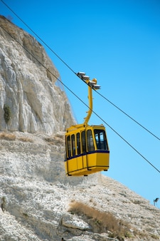 Cableway on mountain with blue sky