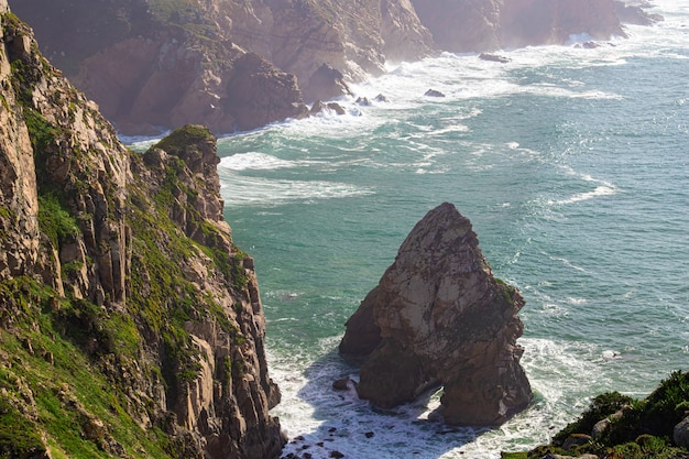 Cabo da roca. cliffs, rocks, waves and clouds on the atlantic ocean coast in sintra, portugal