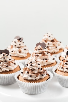 Cacao cupcakes with cheese cream  and chocolate decorations