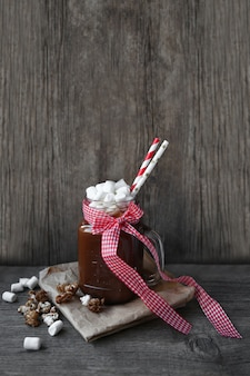 Cacao shake in a jar and marshmallows