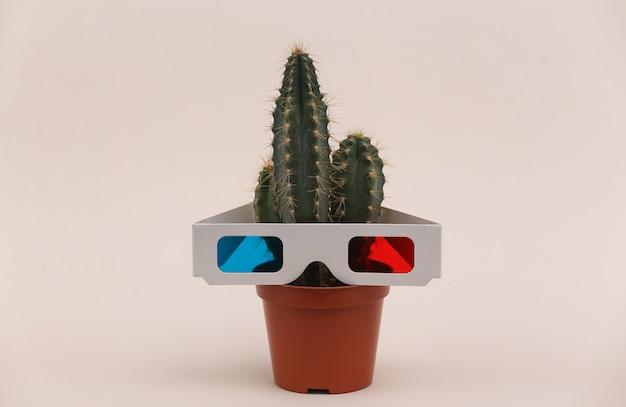 베이지색 배경에 3d 안경이 있는 냄비에 선인장