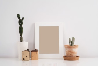 Cactus in clay pot with blank photo frame background