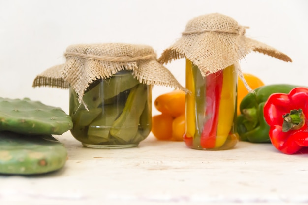 Cactus and pickled peppers in vinegar and salt